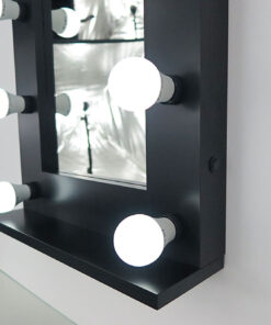 Black theater mirror with 9 lamps, against a wall.
